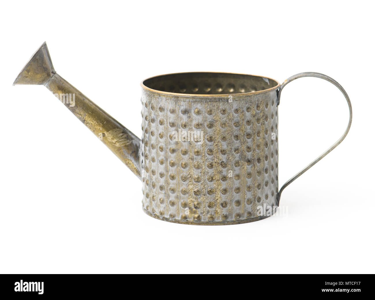 Old vintage metal watering can isolated on white background. - Stock Image