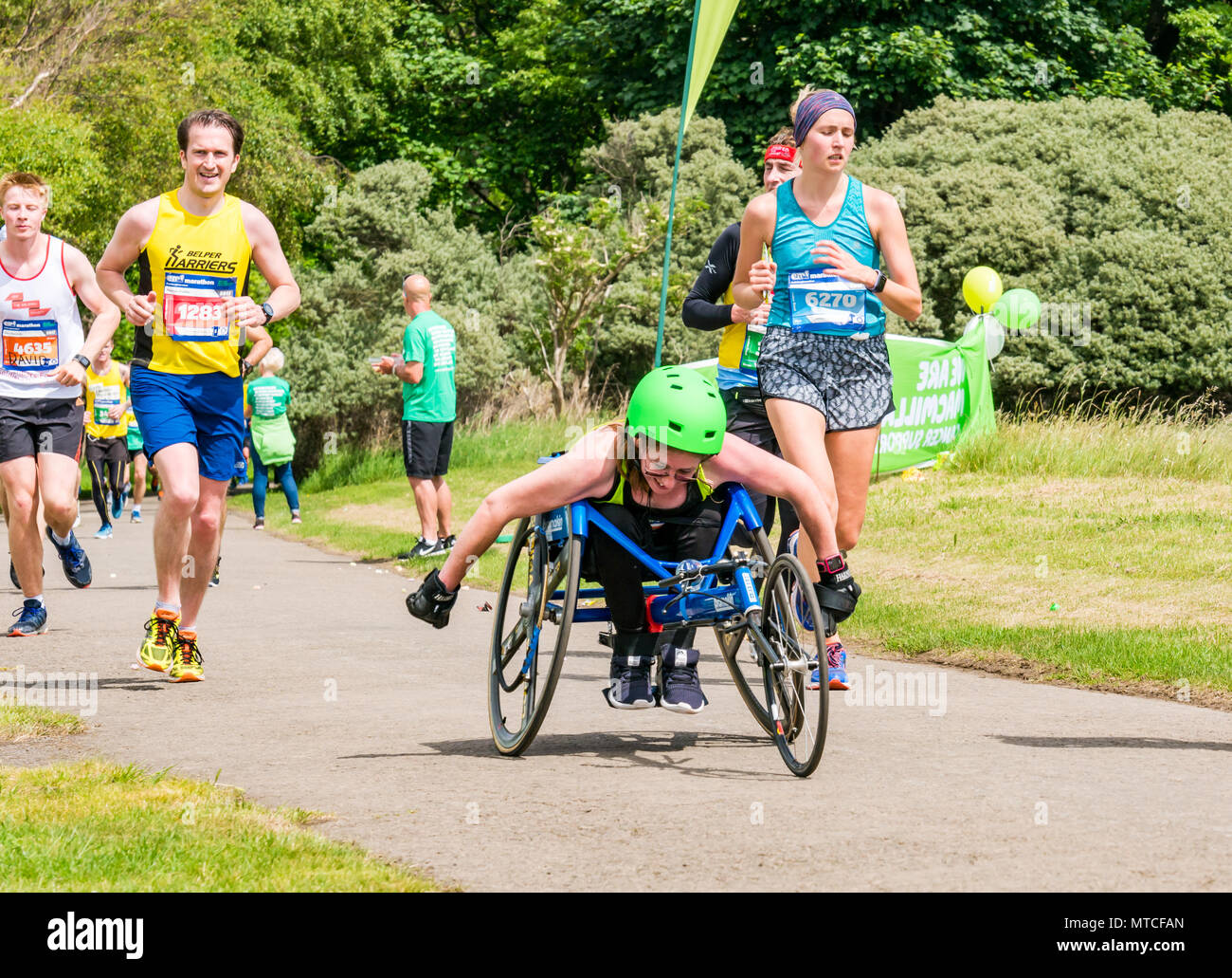 Gosford Estate East Lothian, Scotland, UK. 28th May 2017. Disabled female marathon competitor in hand bike in Edinburgh Marathon at Mile 18 - Stock Image