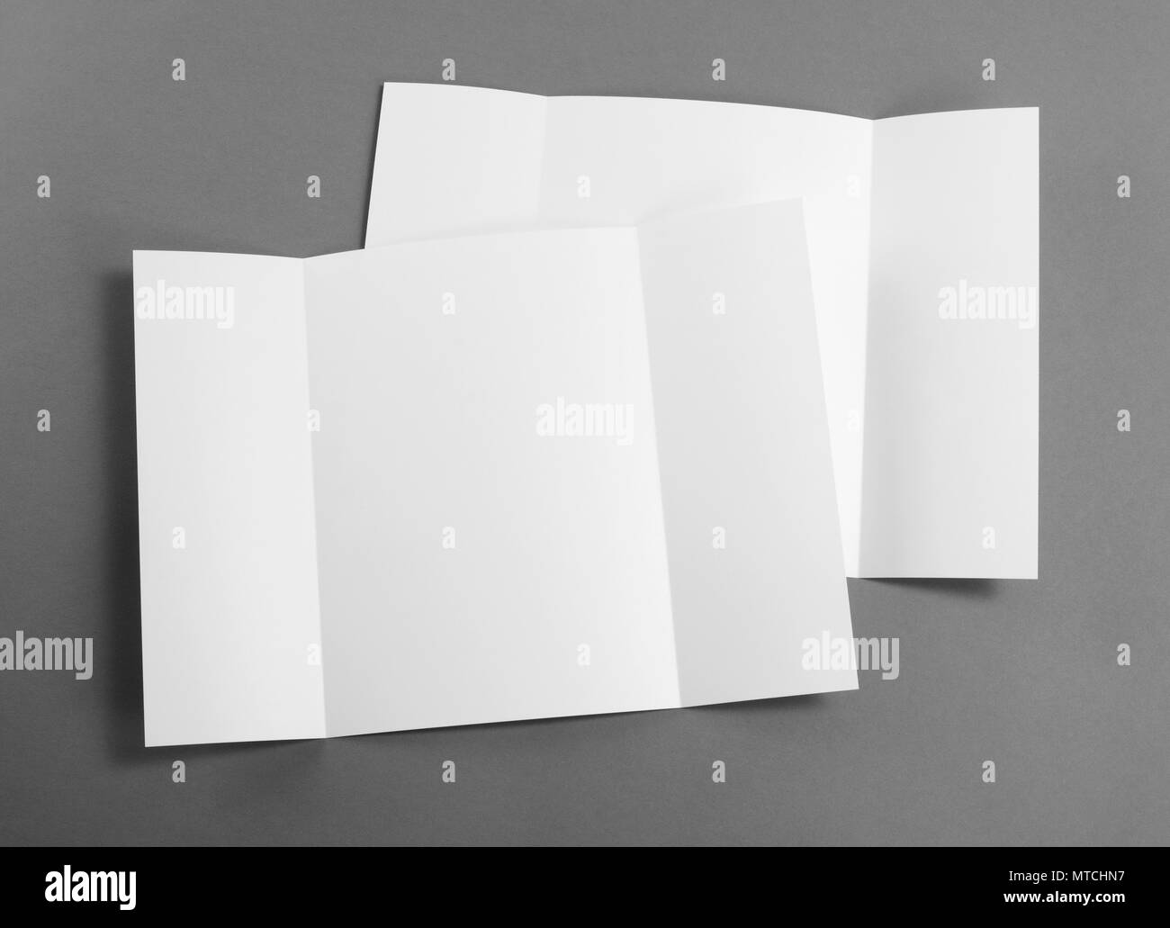 Blank gate fold brochure on grey to replace your design