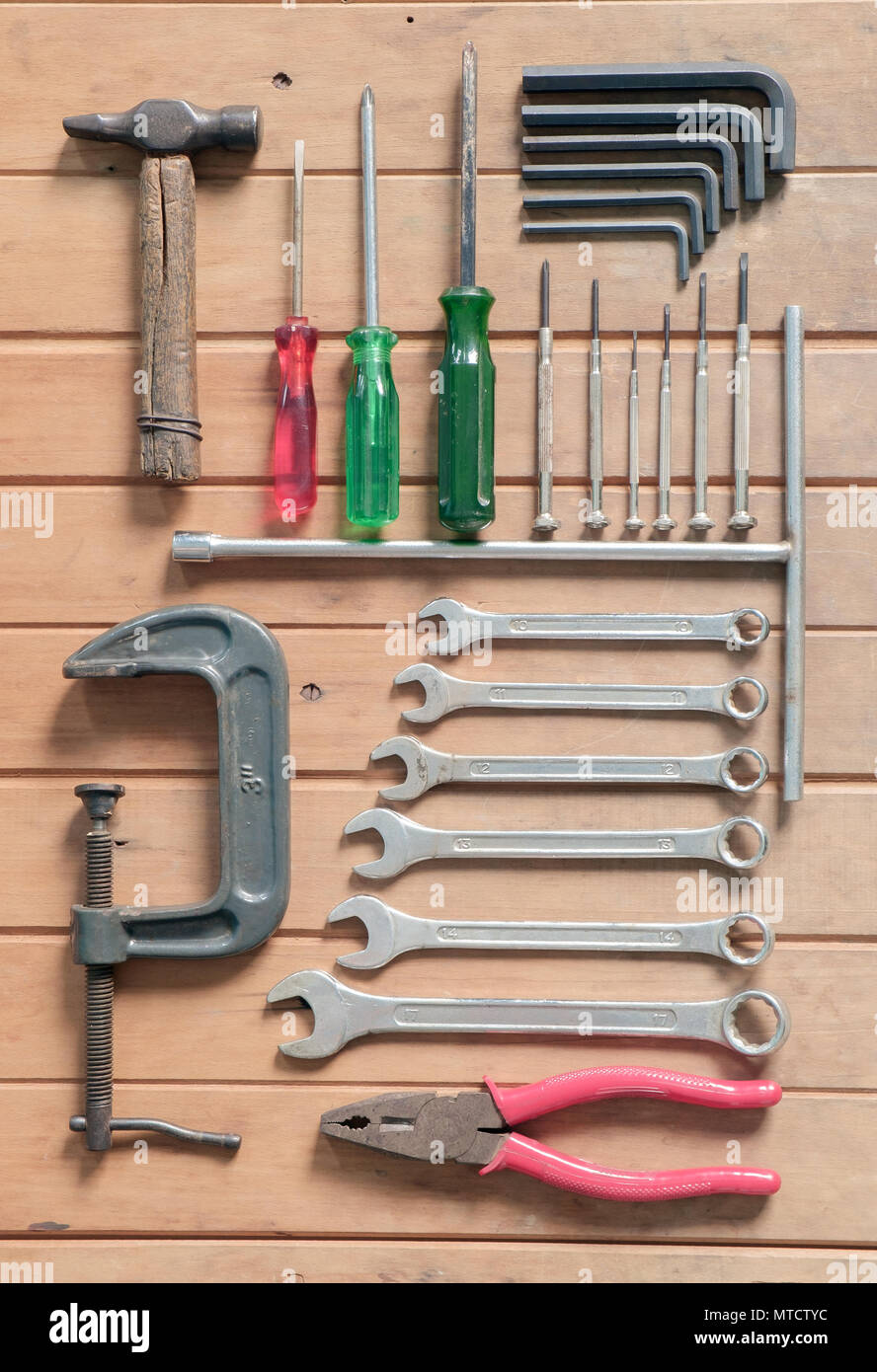 Set of old rusty mechanic tool on wood background. Top view. Flat lay. - Stock Image