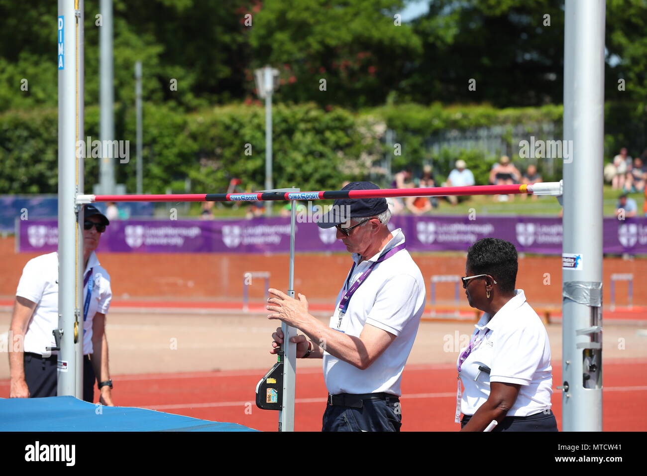 Loughborough, England, 20th, May, 2018.   Officials preparing the High Jump apparatus at the LIA2018 Loughborough International Athletics meeting.     - Stock Image