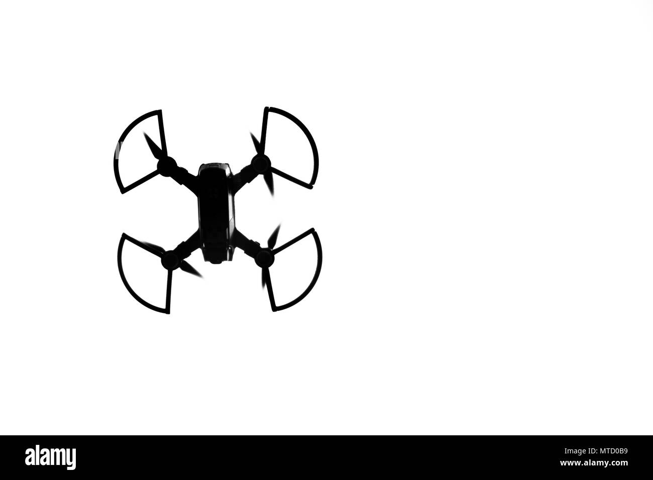 Silhouette of a drone in the sky. - Stock Image
