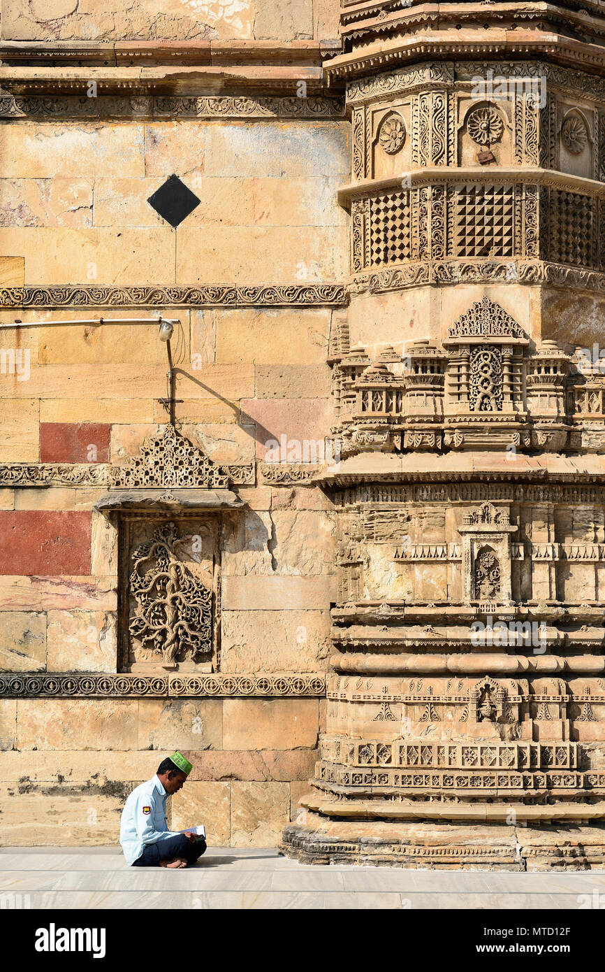 AHMADABAD, GUJARAT, INDIA - 28 JANUARY 2015: A Muslim from India prays in front of the Jama Masijd mosque is the most splendid mosque of Ahmedabad cit - Stock Image