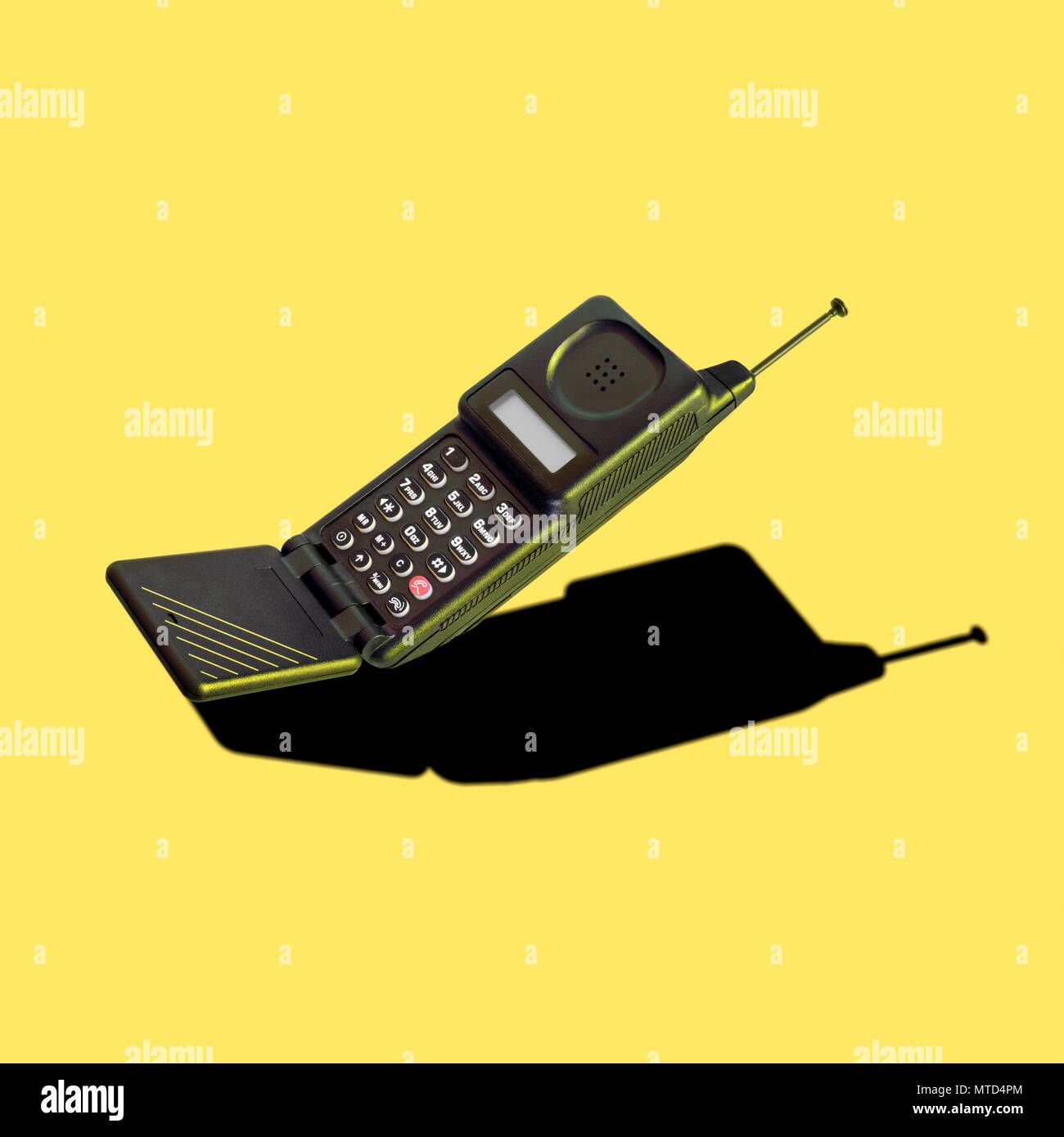 Vintage analog cellular phone with flip mouthpiece, dummy aerial and LED display; it was innovative and trendsetting, and its features were developed  - Stock Image