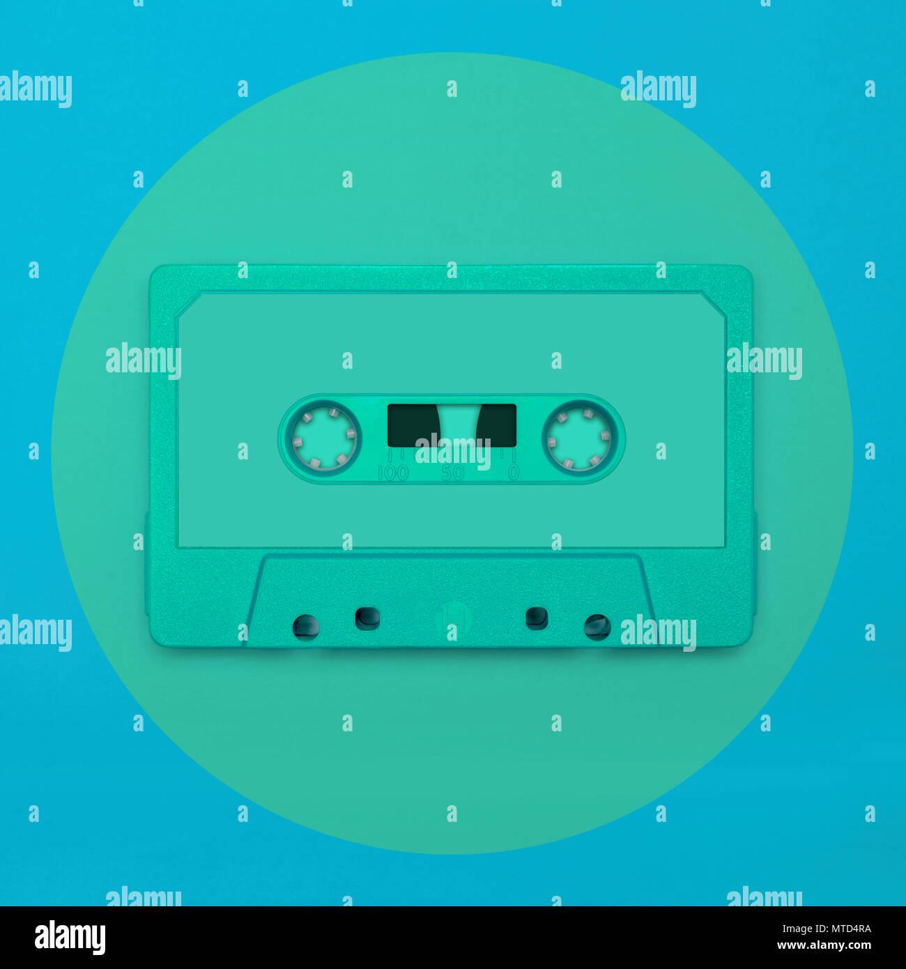 Cassette tape close up, blank for customisation of label, isolated and framed in a circle, for nostalgic creative design web & print - Stock Image