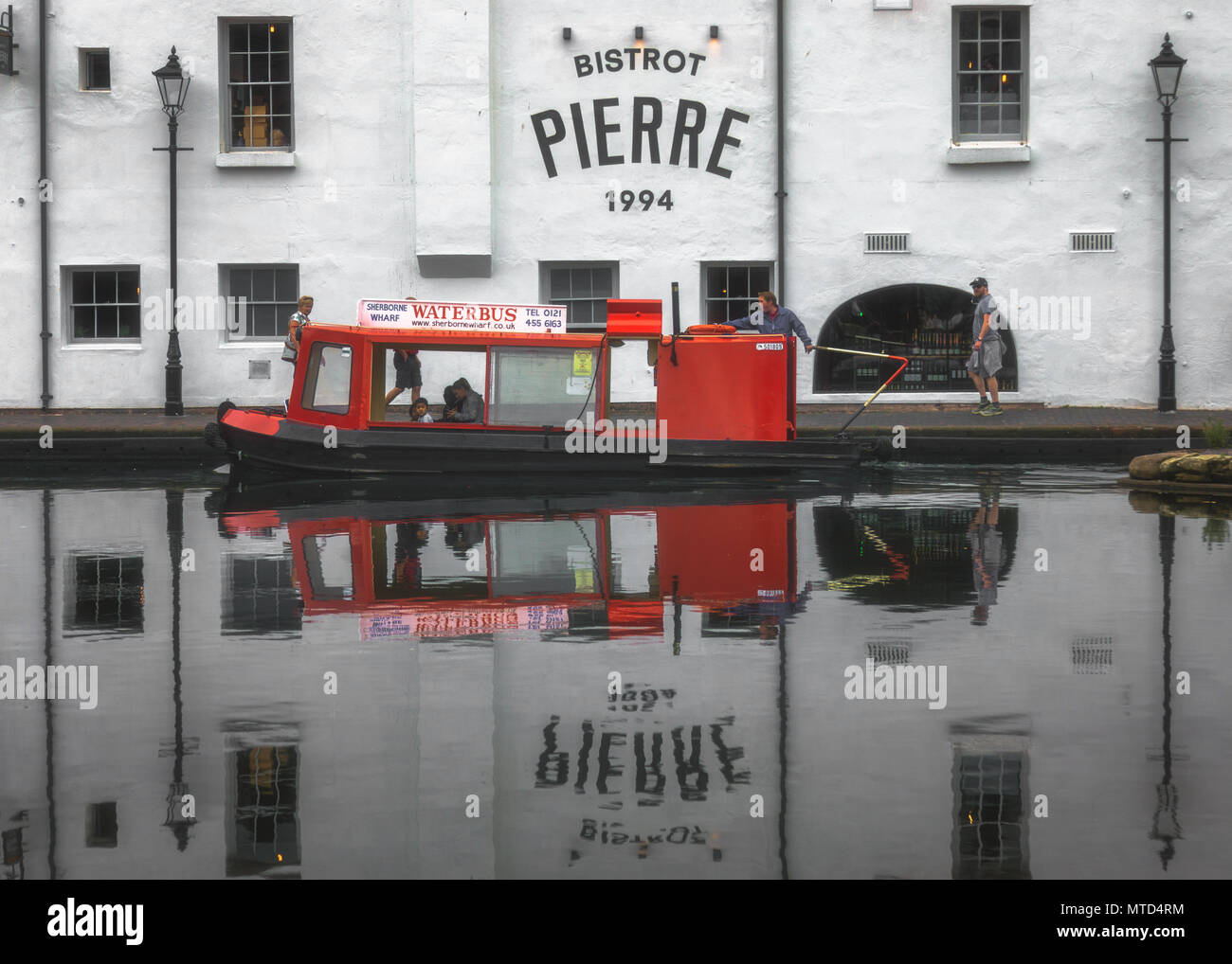 Pierre Bistro and water bus reflection in the Gas Street Basin canal in Birmingham - Stock Image