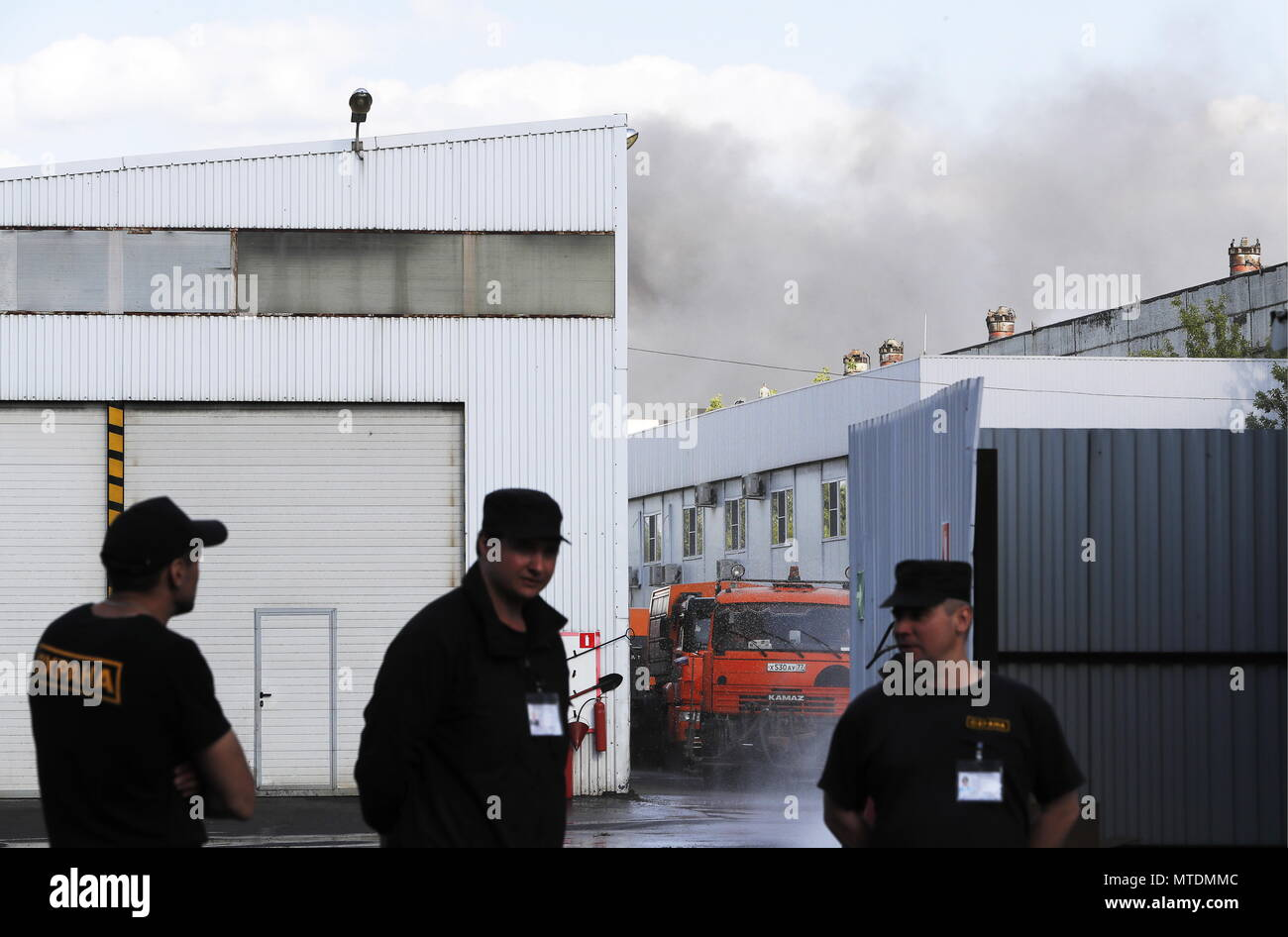 MOSCOW, RUSSIA   MAY 30, 2018: Security Staff On Guard During A Fire