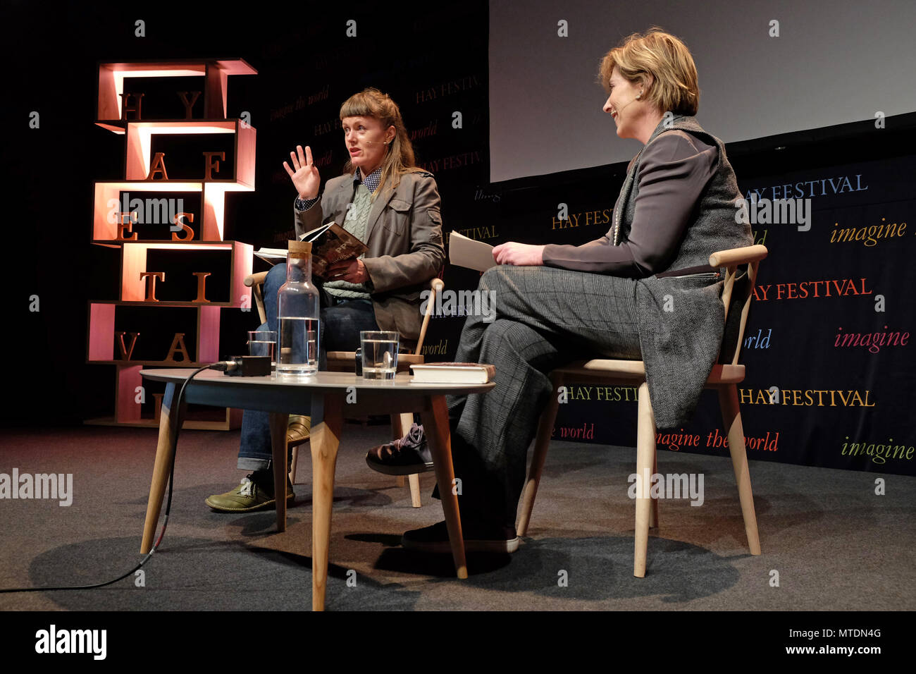 Hay Festival, Hay on Wye, UK - Wednesday 30th May 2018 - Author Nicola Barker talks about her new post-post apocalyptic novel H(A)PPY with host Georgina Godwin ( on right ) - Photo Steven May / Alamy Live News - Stock Image