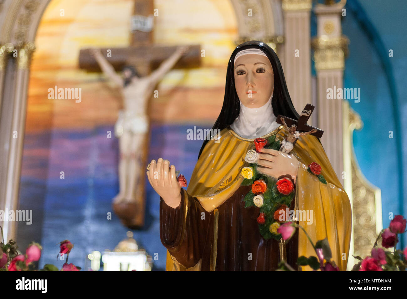 A statue of Saint Therese seen display next to the Shrine of Saint Therese of the Child Jesus in New Port City in Pasay, Metro Manila. The reliquary containing the bones of Saint Therese has been on a nation wide tour and is on its last few days in Manila before heading back to France. - Stock Image