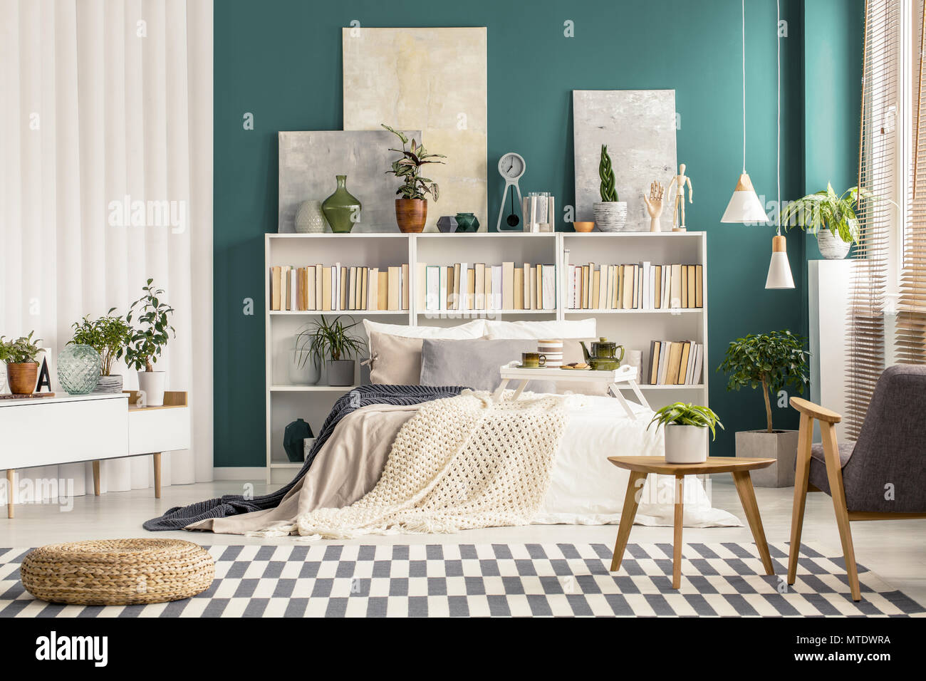Checkered Rug And Modern Wooden Furniture In A Stylish Bedroom Interior For Art And Nature Lover Stock Photo Alamy