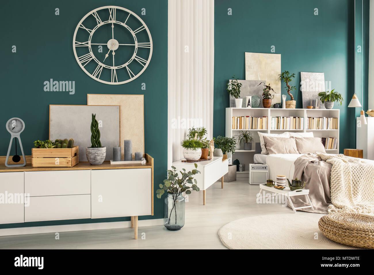 Modern studio apartment interior with cozy bedroom, white wooden ...