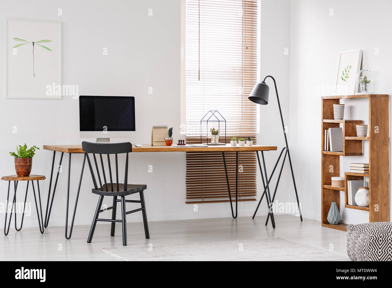 Black Chair At Wooden Desk With Computer Monitor In Bright