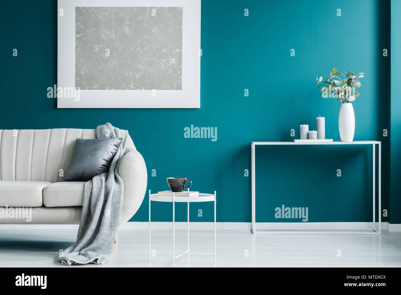 Grey Painting On The Green Wall White Coffee Table Desk And