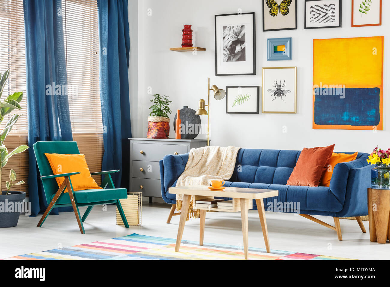 Real photo of a colorful living room interior with a green ...