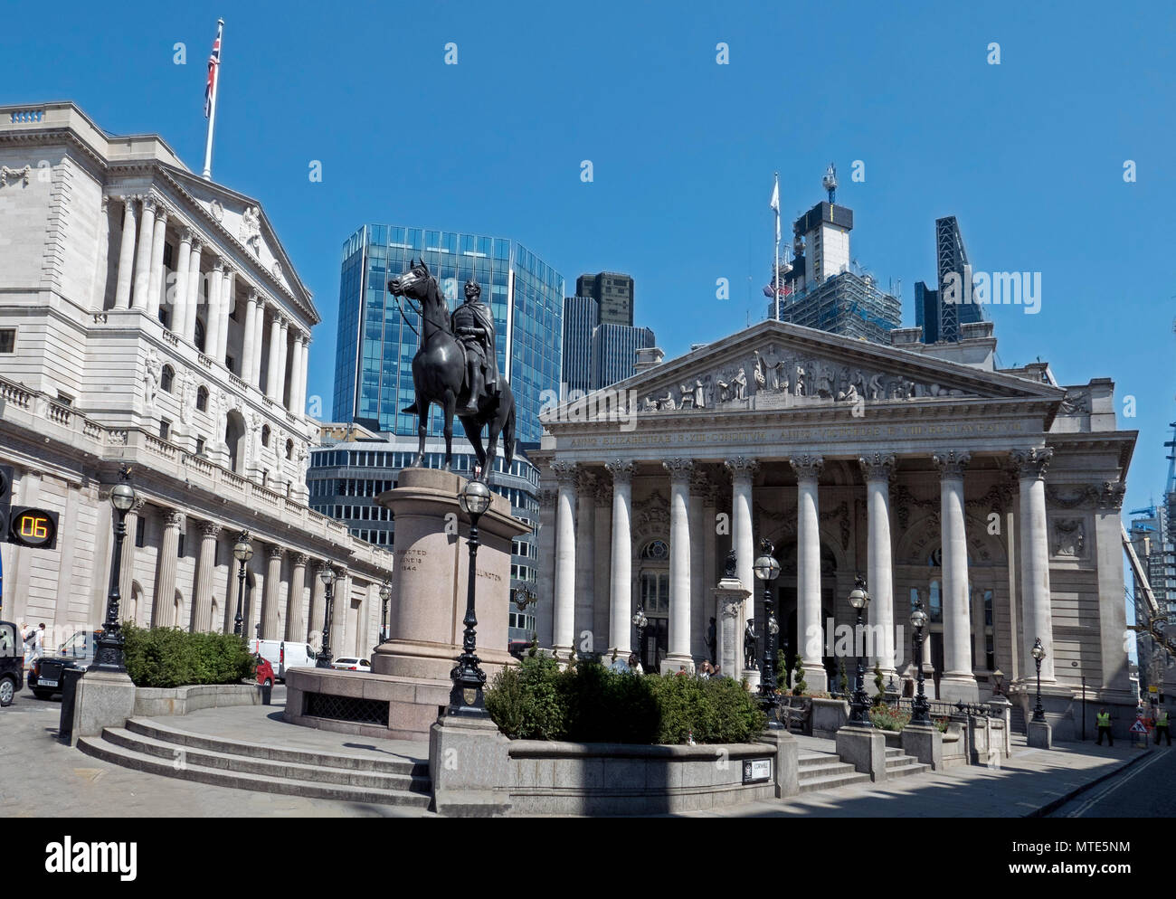 View from Bank Junction of Bank of England, Duke of Wellington Statue & Royal Exchange under clear blue summer sky - Stock Image