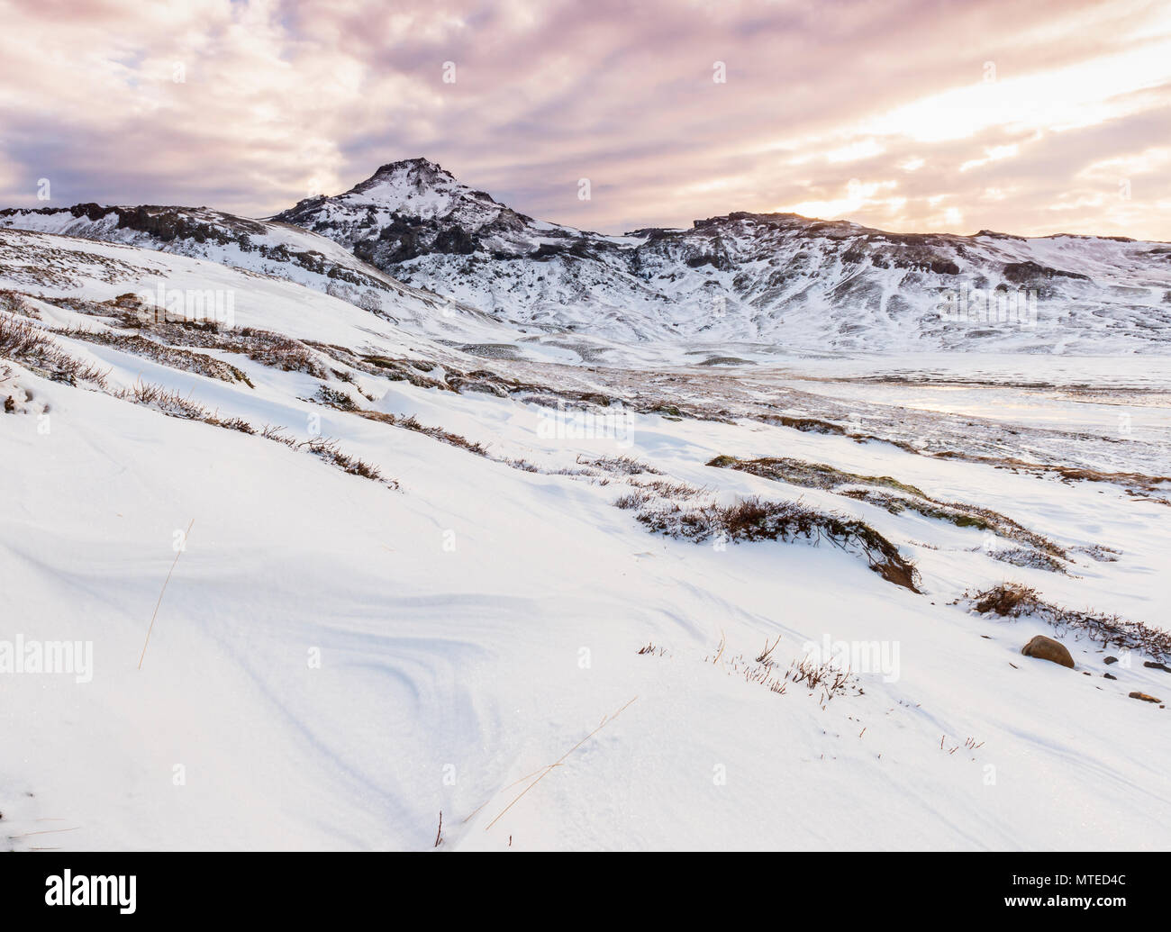Volcanic landscape with snow, evening mood, Mount Horn, West Iceland, Vesturland, Iceland - Stock Image