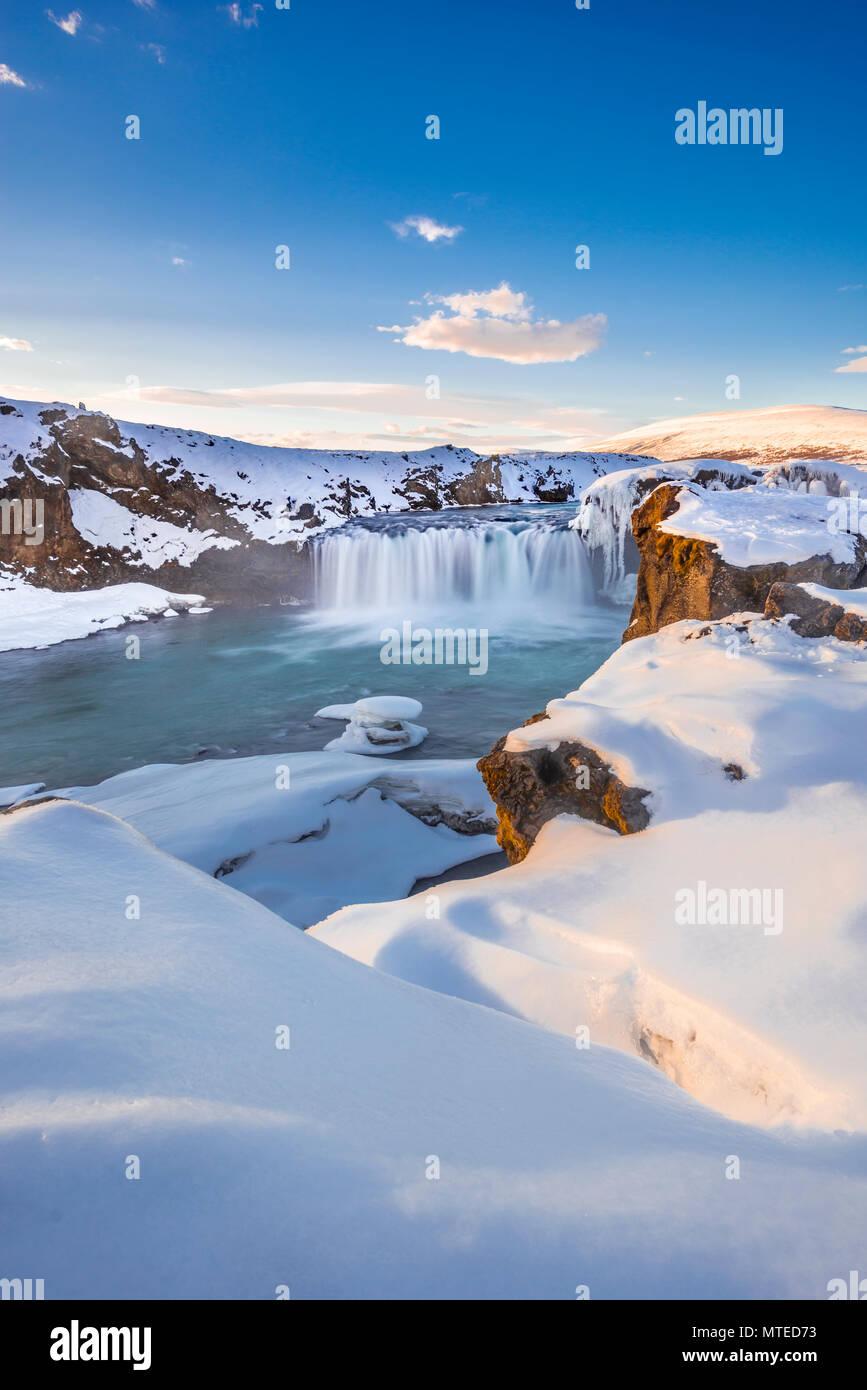 Evening trimming, waterfall Góðafoss, Godafoss in winter with snow and ice, Skjálfandafljót river, Norðurland vestra - Stock Image