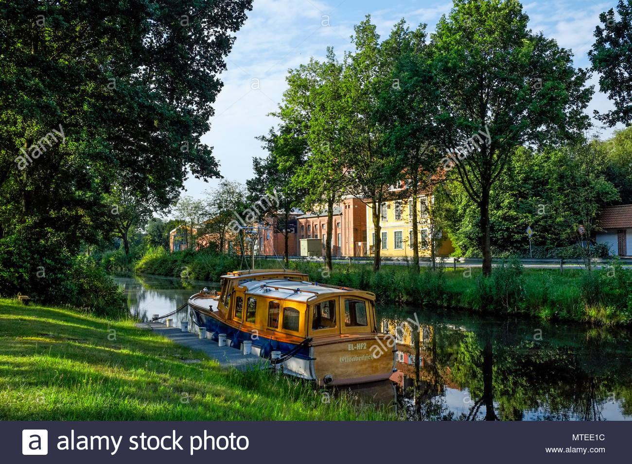 The classic motorlaunch Kaiser Wilhelm is anchored in the Elisabethfehn Kanal, Niedersachsen, Deutschland. Stock Photo