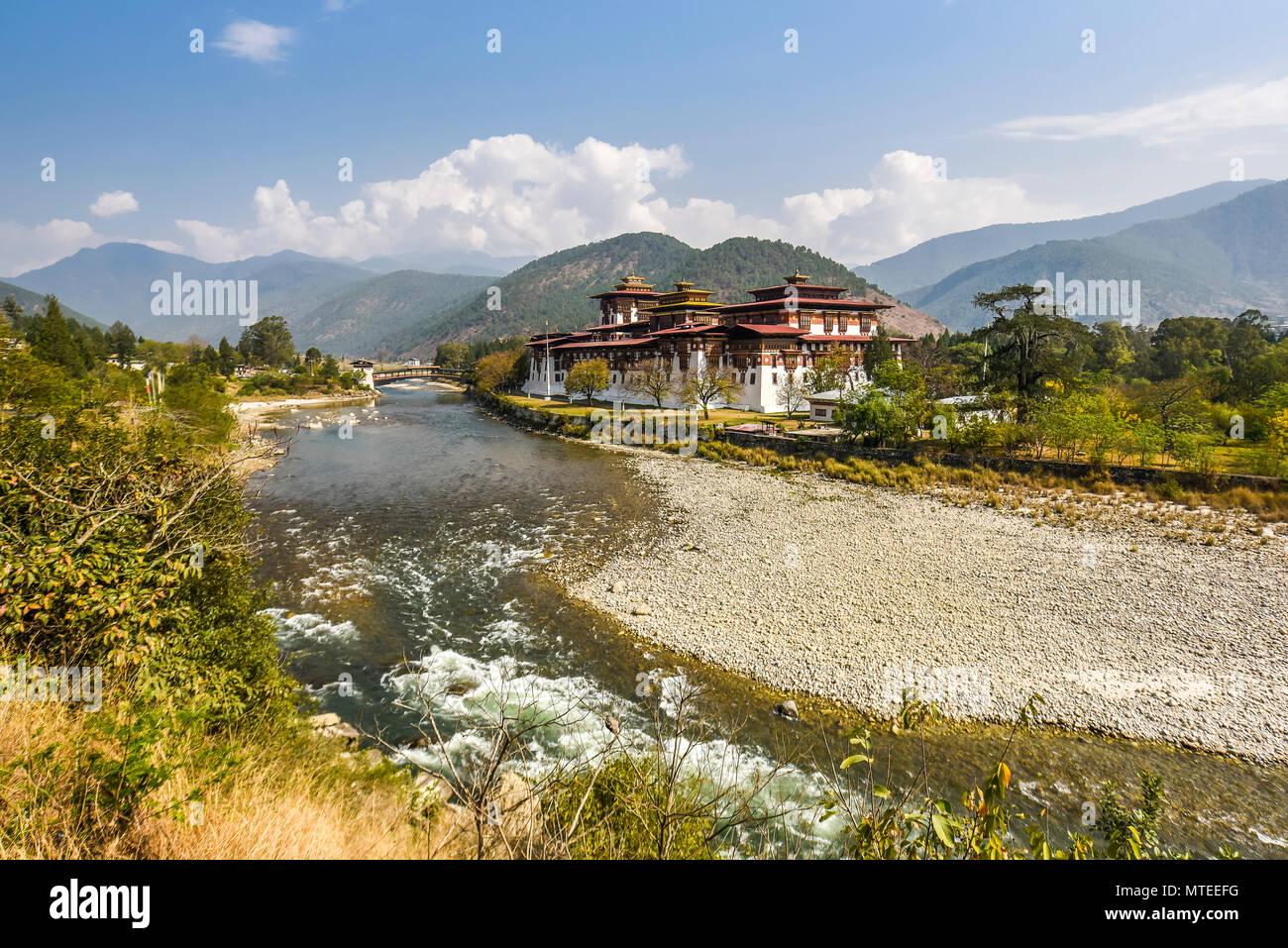Buddhist monastery fortress Punakha Dzong at the river Mo Chhu, Punakha, Bhutan - Stock Image