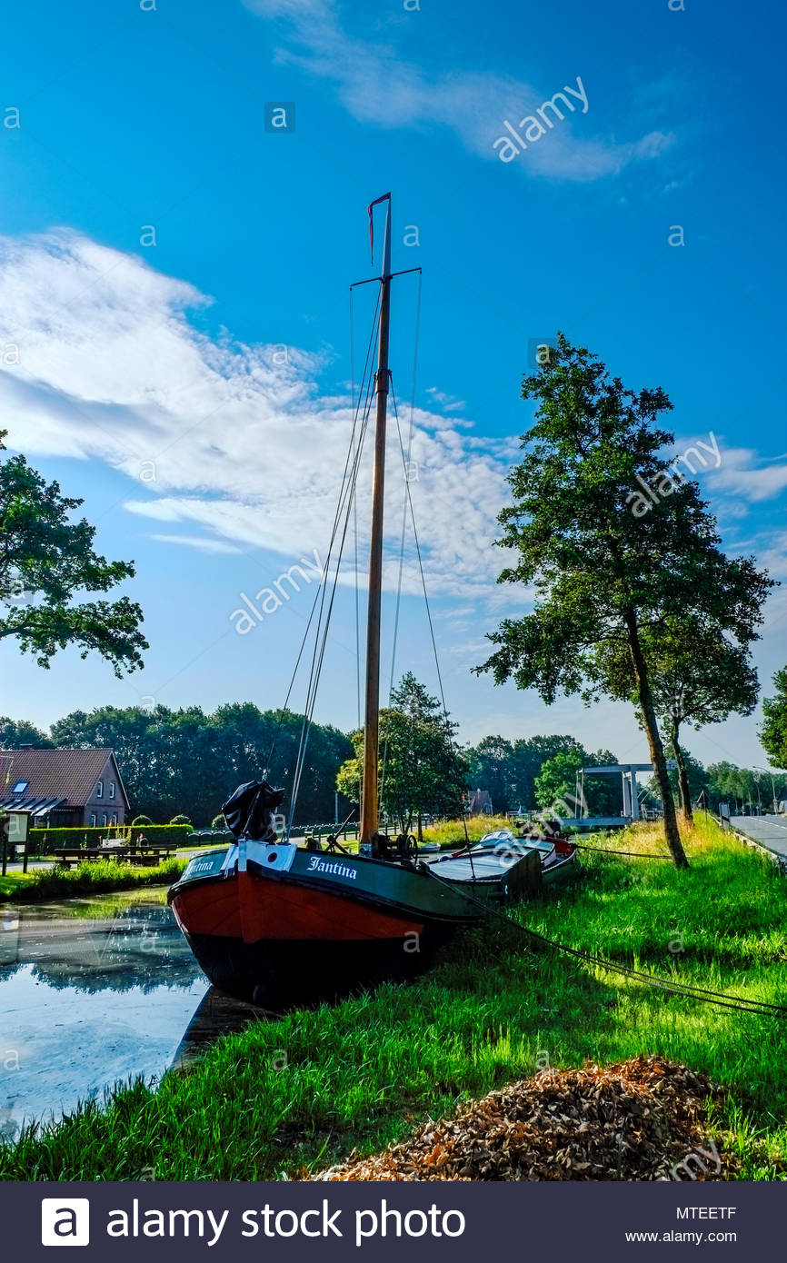 The canal boat Fantina is moored in the Elisabethfehn-Kanal, Barssel, Friesland, northern Germany. - Stock Image
