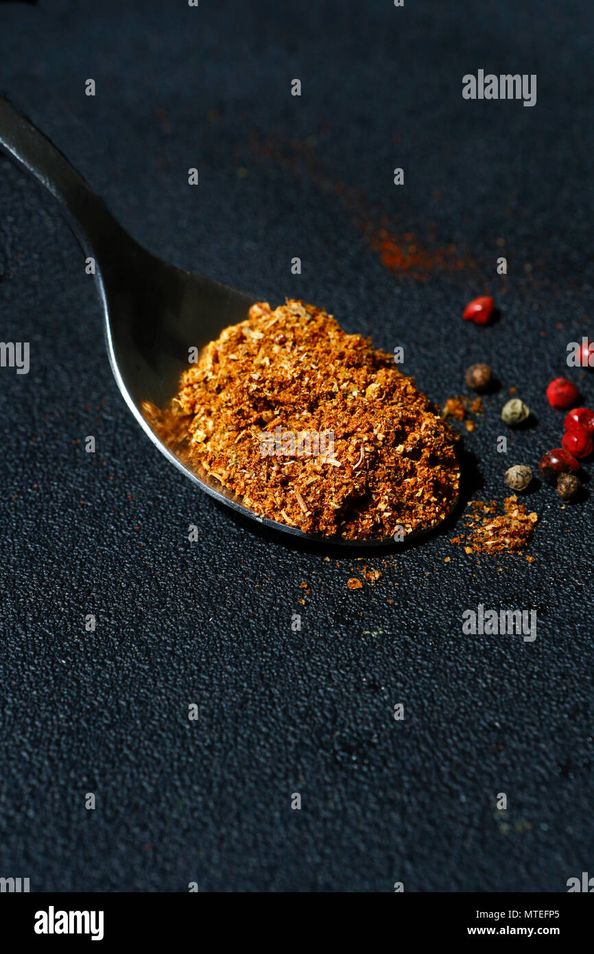Mixed dry spices in a spoon Stock Photo