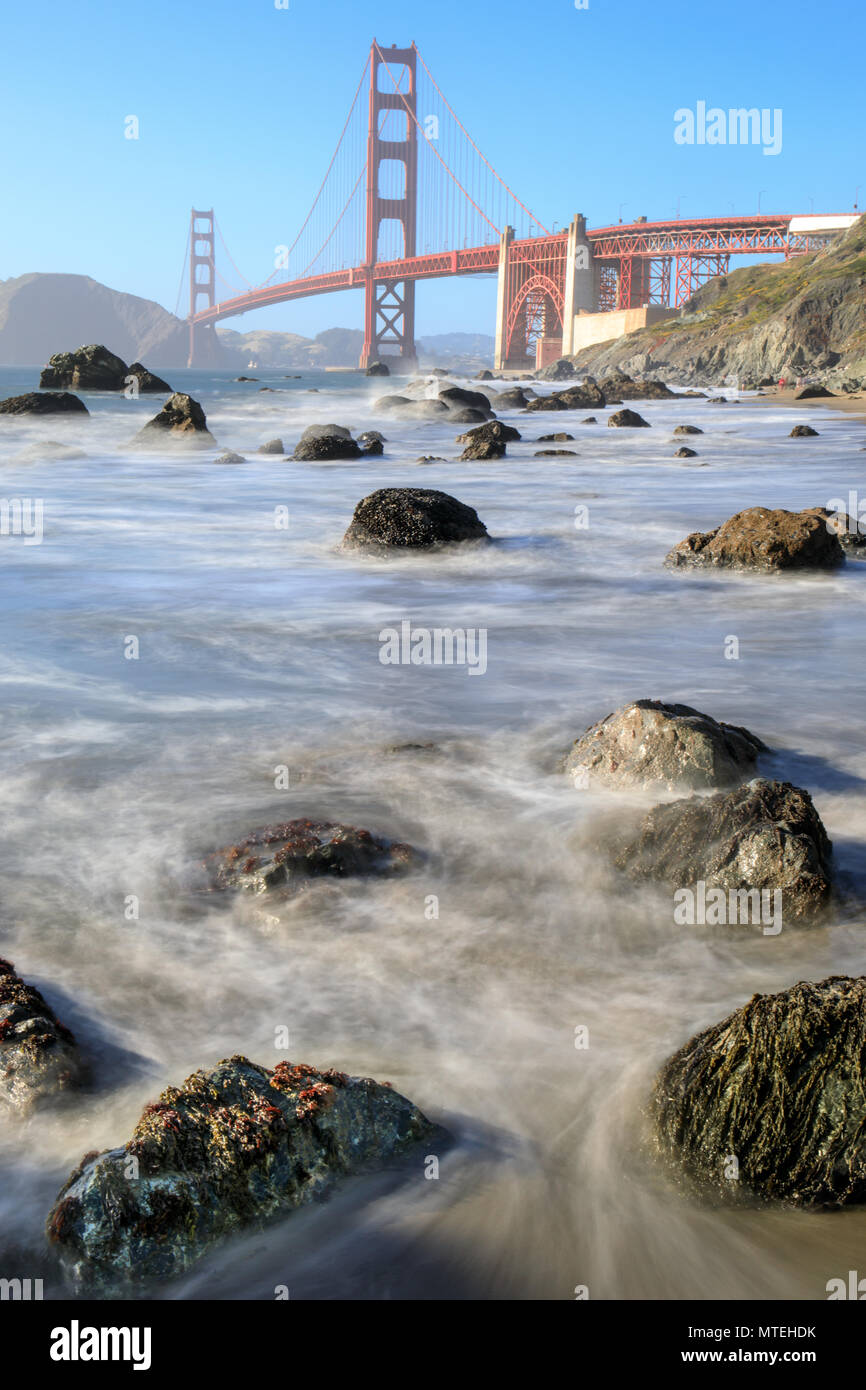 View of the Golden Gate Bridge from Rugged Marshall Beach in High Tide. - Stock Image
