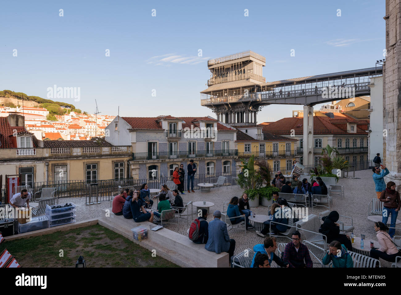 Lisbon, Portugal - May 03, 2018: People are enjoying their drink in an outdoor bar near the  Santa Justa Lift / Elevador de Santa Justa, Lisbon, Portu Stock Photo