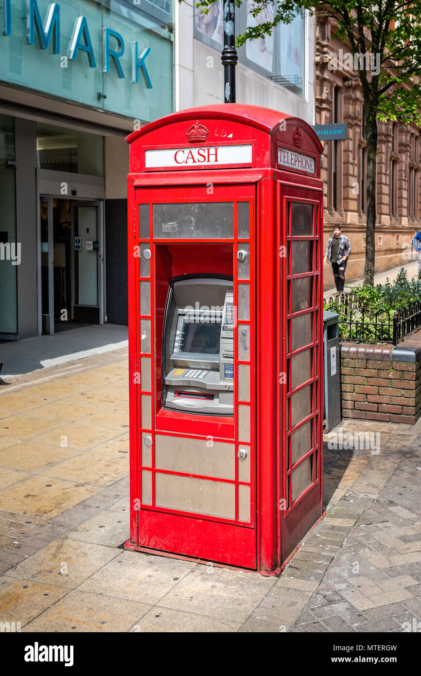 Cash machine in a red telephone kiosk taken in the High Street, Lincoln, East Midlands, UK on 23 May 2018 - Stock Image