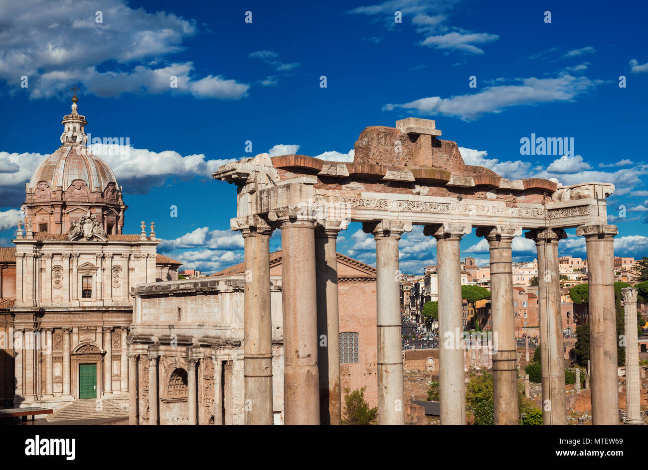 Paganism and Christianity in Rome. Ancient temple and baroque church face each other in Roman Forum - Stock Image