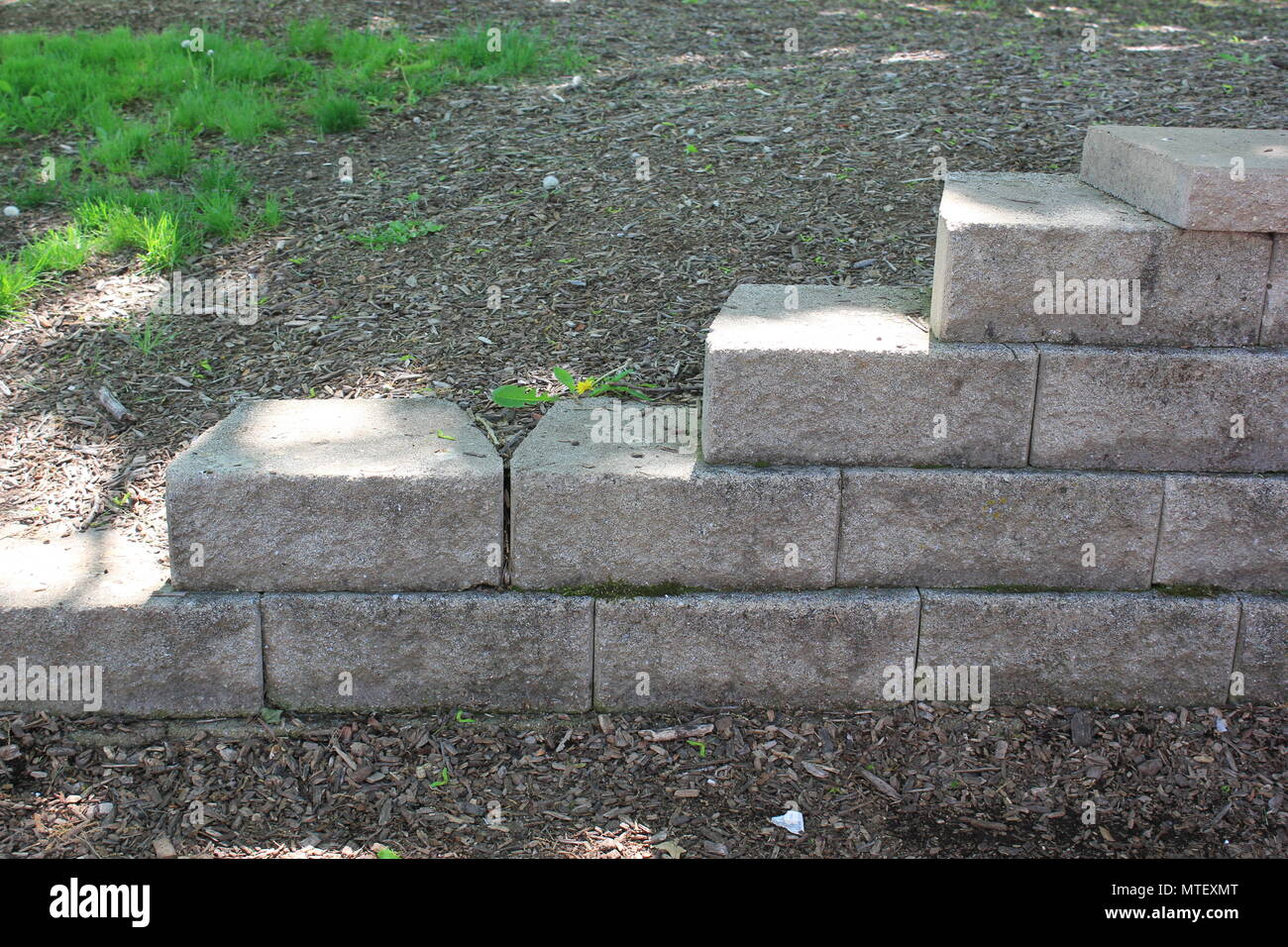 Professionally landscaped stairs located in Golf Mill Park in small-town Niles, Illinois. - Stock Image