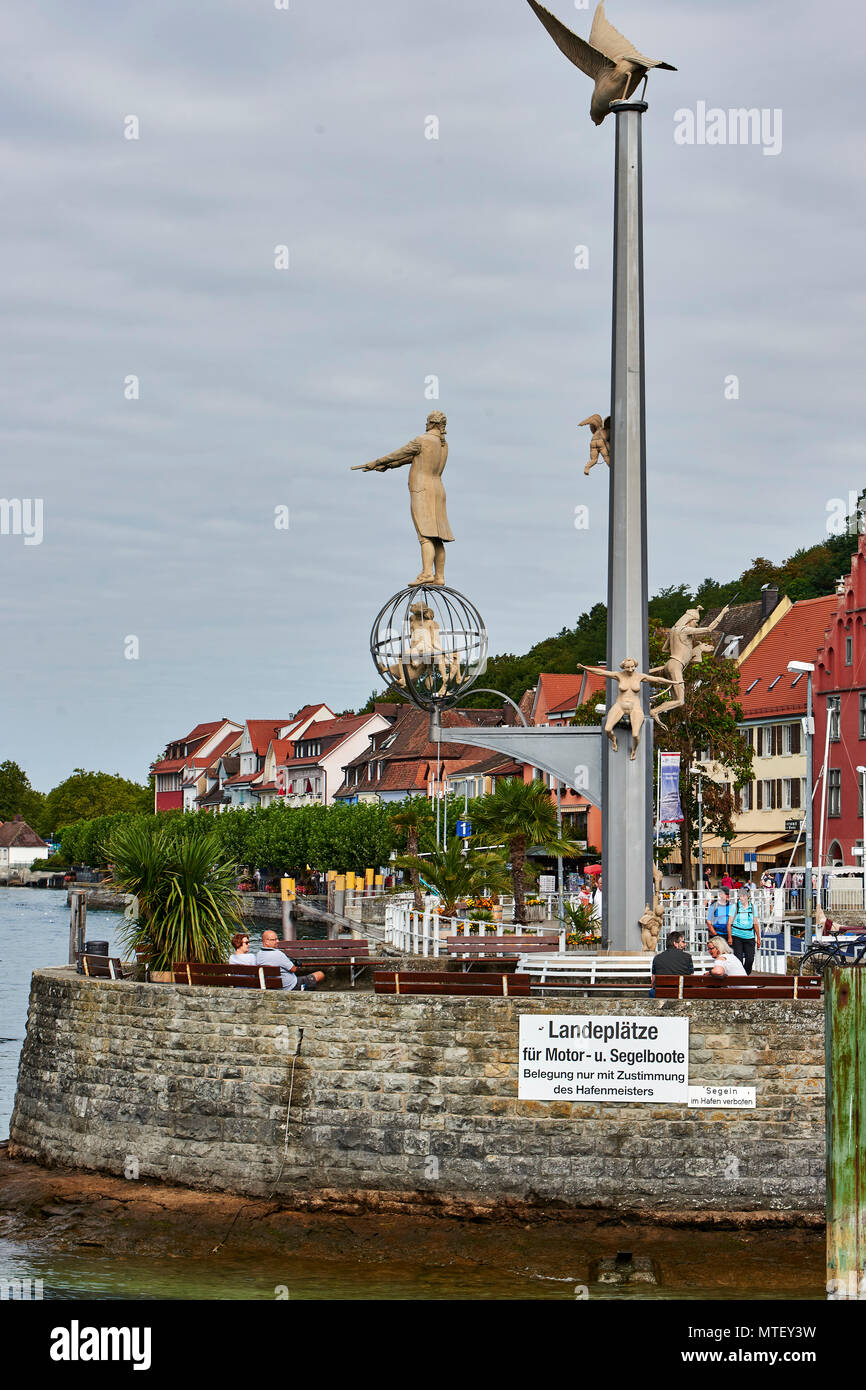 Unique statues on the breakwater at Meersburg harbour: gull, columbus, ugly woman, soldier - symbolic of human nature - Stock Image
