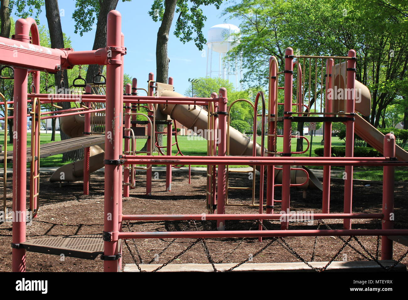 Golf Mill Park playground equipment and accessories in small-town Niles, Illinois on a hot sunny summer day. - Stock Image