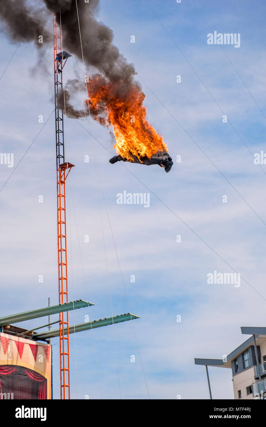 High diving stuntman covered in flames Stock Photo