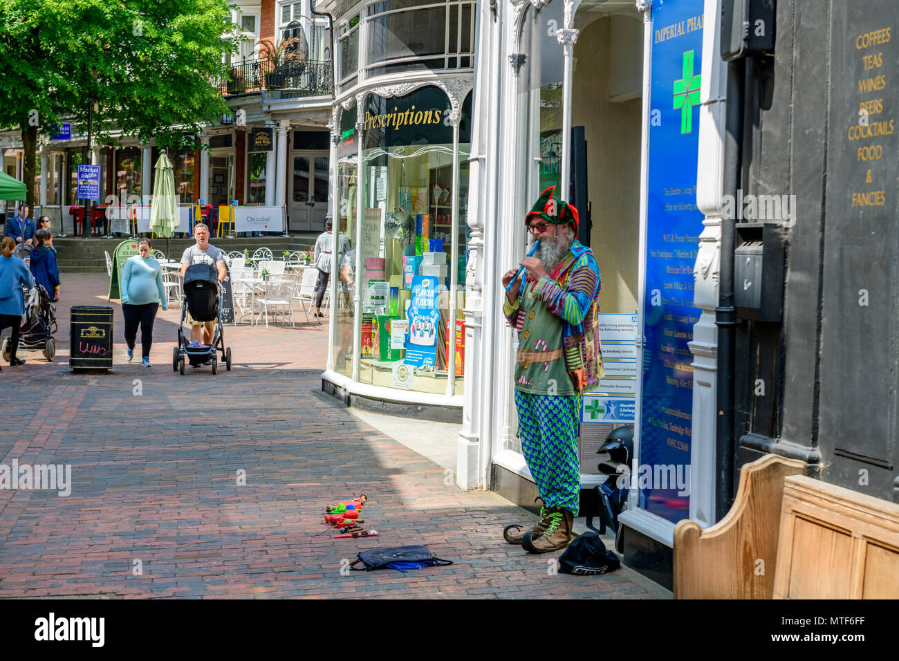 man in fancy dress busking with a recorder tunbridge wells uk - Stock Image