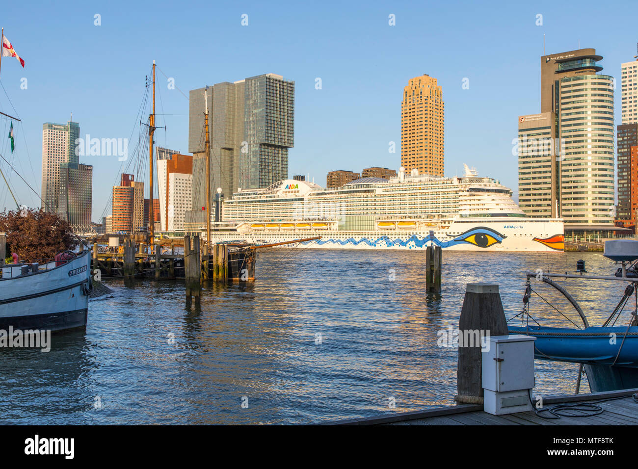 Rotterdam, skyline on the Nieuwe Maas,  skyscrapers at the 'Kop van Zuid' district, cruise ship 'Aida Perla' at the Cruise Terminal, - Stock Image