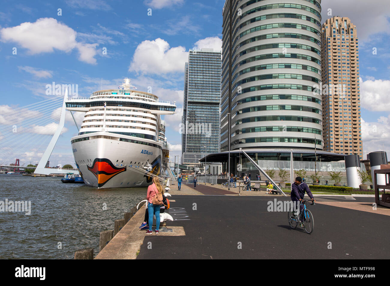 The skyline of Rotterdam, on the Nieuwe Maas, at the 'Kop van Zuid' district, Netherlands, Hotel New York, Aida Perla Cruise ship at the Cruise Termin - Stock Image