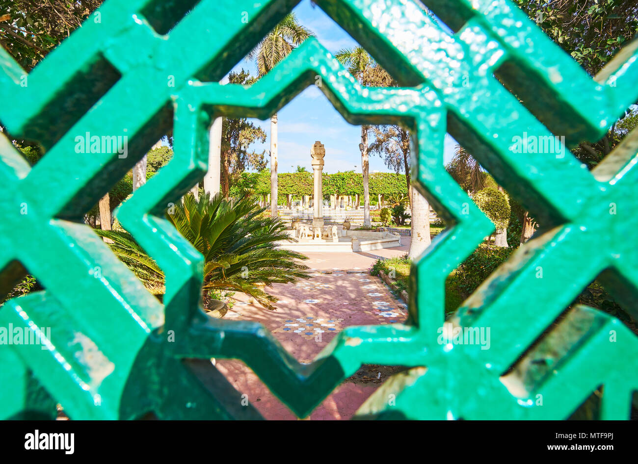 The view on Andalusian Garden through the octagonal Arabian star - Rub el Hizb (Muslim symbol) of the fence, Gezira Island, Cairo, Egypt. - Stock Image