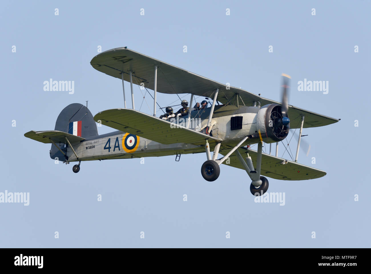 Fairey Swordfish plane flying at an airshow. Royal Navy Fleet Air Arm biplane carrier borne aircraft used in the Second World War as torpedo bomber - Stock Image