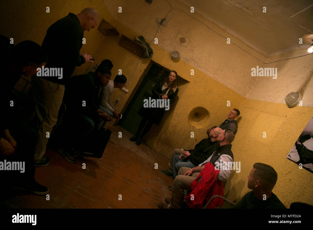 U.S. Marines with Black Sea Rotational Force 17.1  check out a holding cell during a tour of the KGB Corner House museum in Riga, Latvia, April 23, 2017. The event was part of cultural day for the Marines who got the chance to learn more about Latvian history and culture. - Stock Image