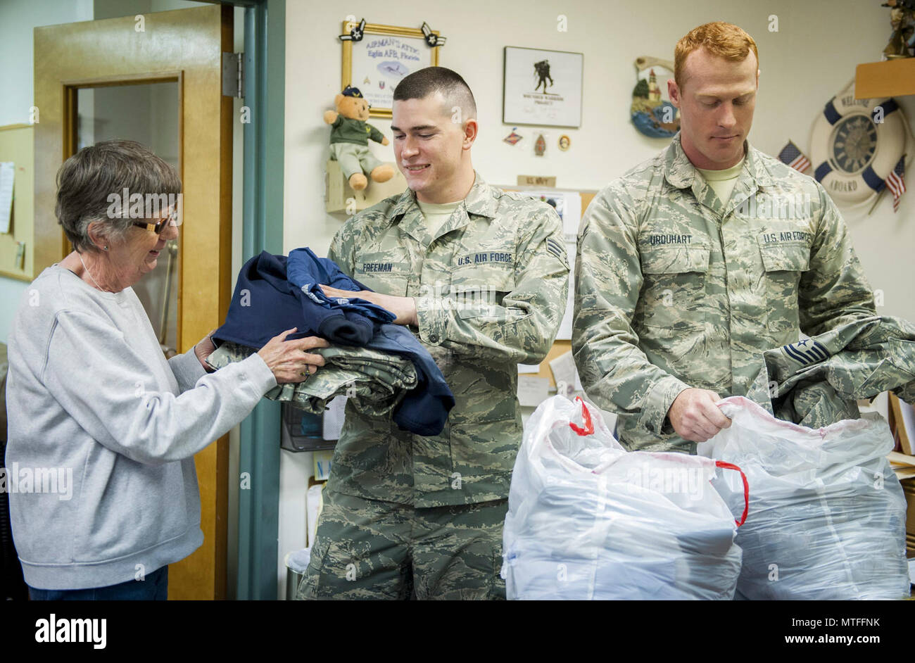 ... from the 96th Logistics Readiness Squadron hand donated uniform items to Fran Moore an Airmanu0027s Attic volunteer during Volunteer Week ...  sc 1 st  Alamy & Senior Airman Skylar Freeman (center) and Airman 1st Class Jeffrey ...