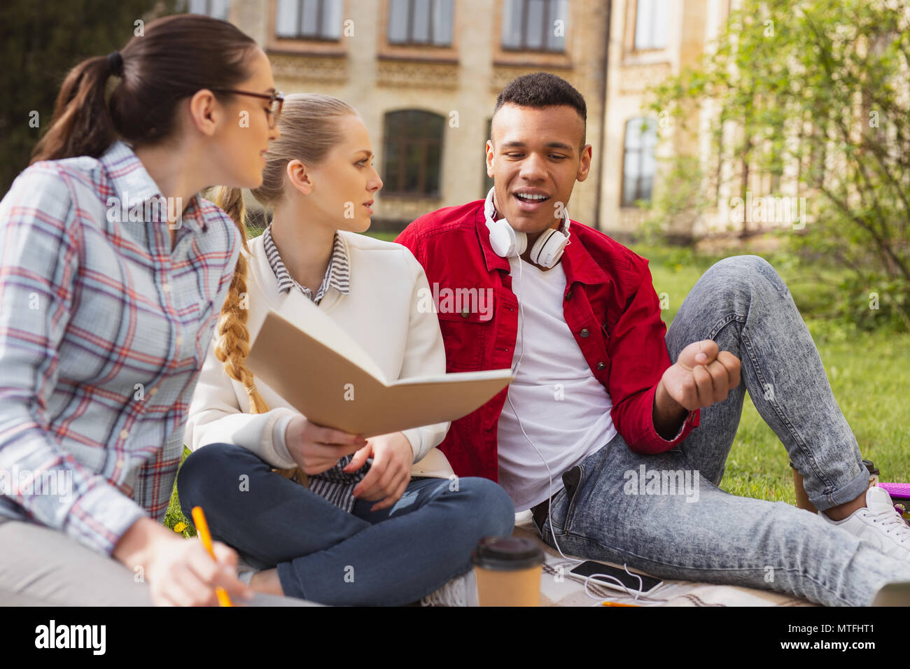 Socially active students conveying university poll - Stock Image
