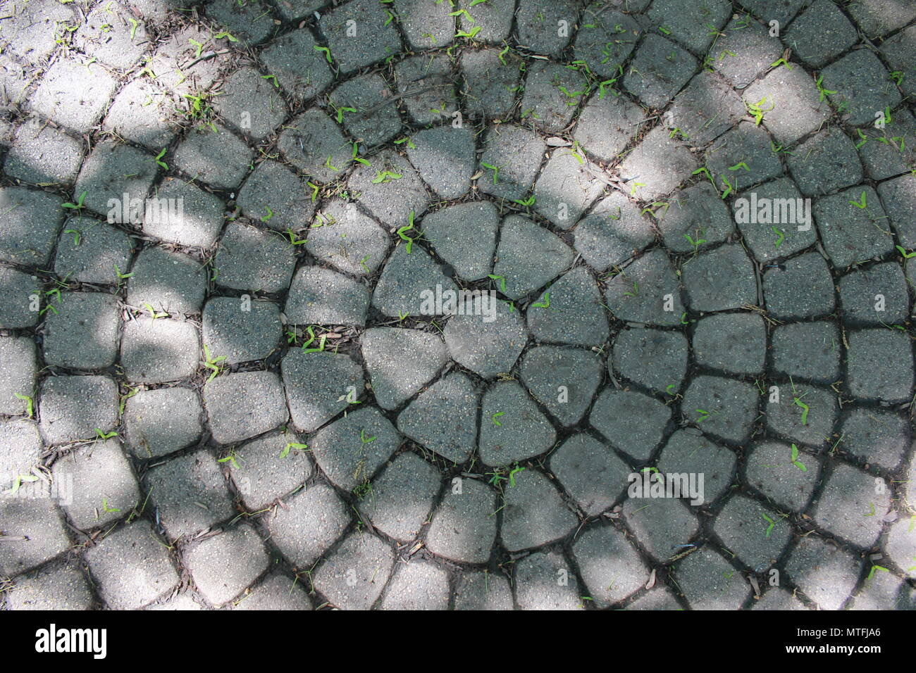 Ring of professionally landscaped masonry blocks radiating from the center of the design. - Stock Image