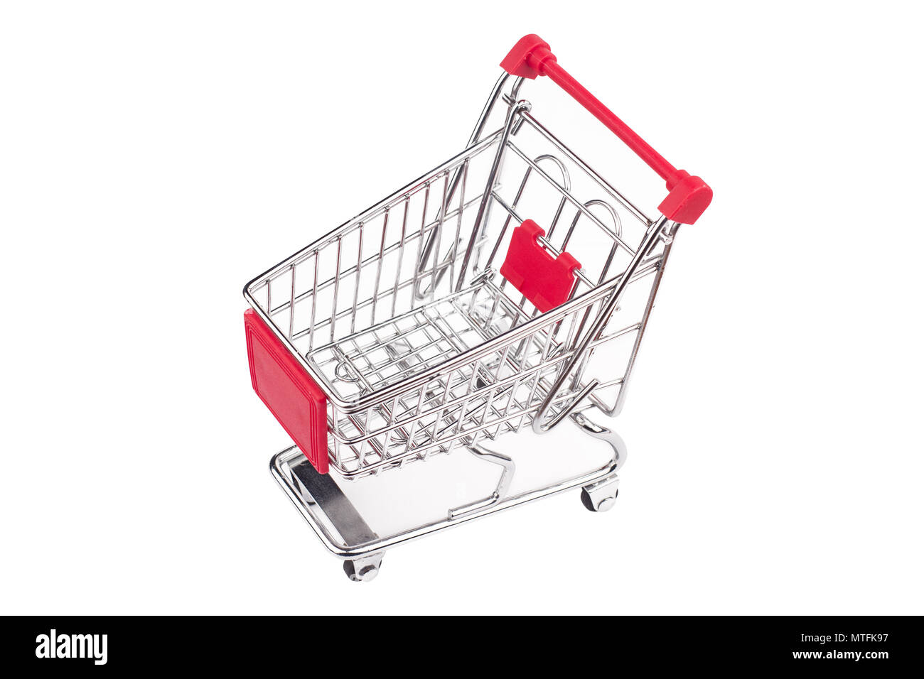 top view closeup of shiny aluminum empty miniature shopping supermarket cart with red handle isolated on white background Stock Photo