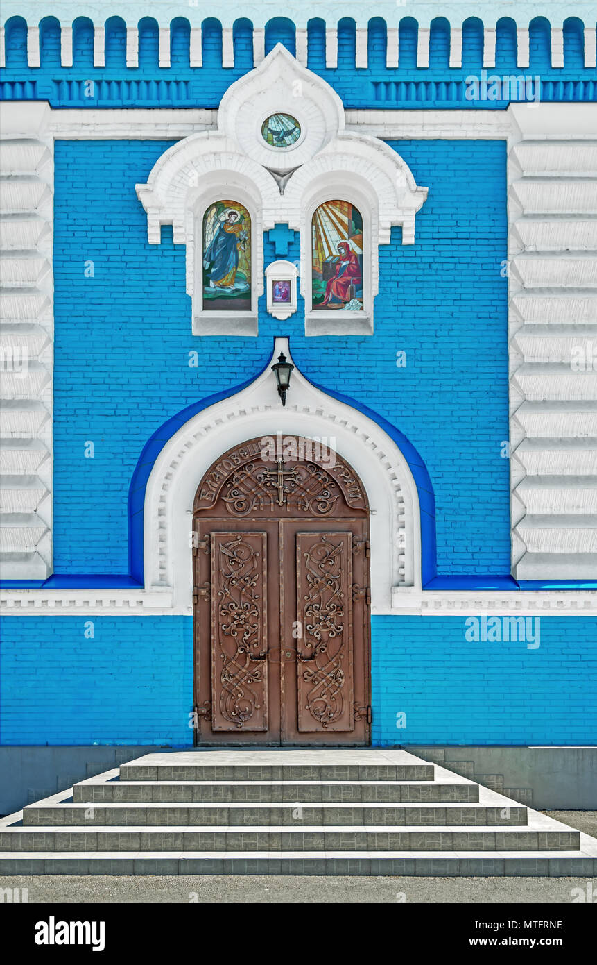 Closed metal forged front door leading inside the Orthodox Church - Stock Image