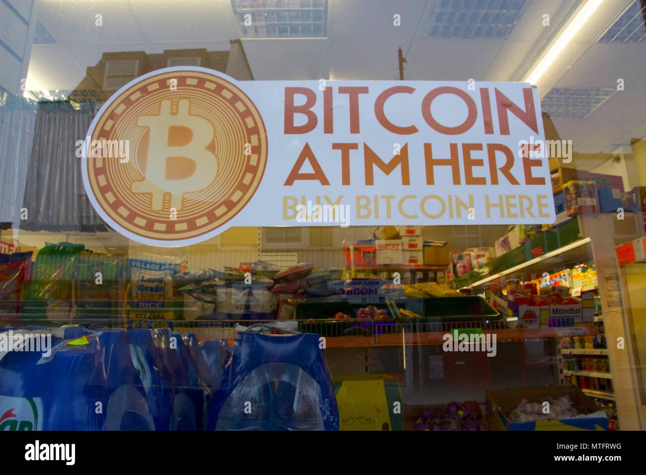 A shop window in london with a sign for a bitcoin atm buy bitcoin a shop window in london with a sign for a bitcoin atm buy bitcoin here showing the rising popularity of the currency ccuart Choice Image