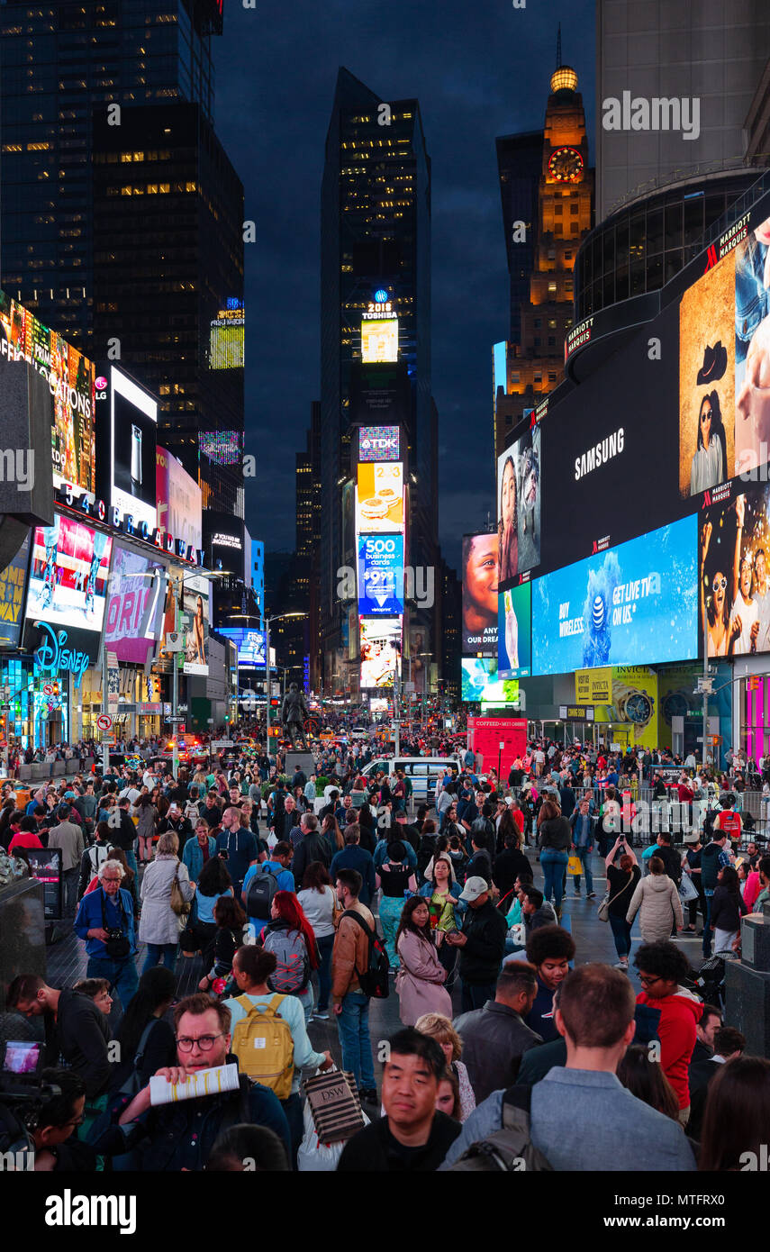 Times Square New York at night, with crowds of people and colorful neon signs; Broadway, Times Square, Midtown, New York city, USA - Stock Image