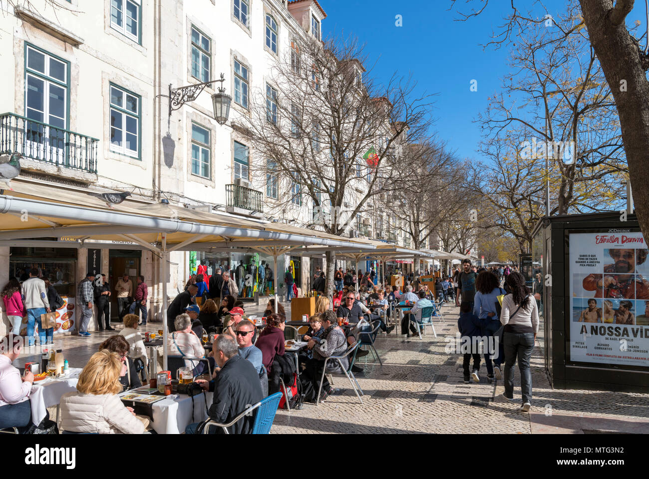 Cafes and shops on Praca Dom Pedro IV ( Rossio ), Baixa district, Lisbon, Portugal - Stock Image
