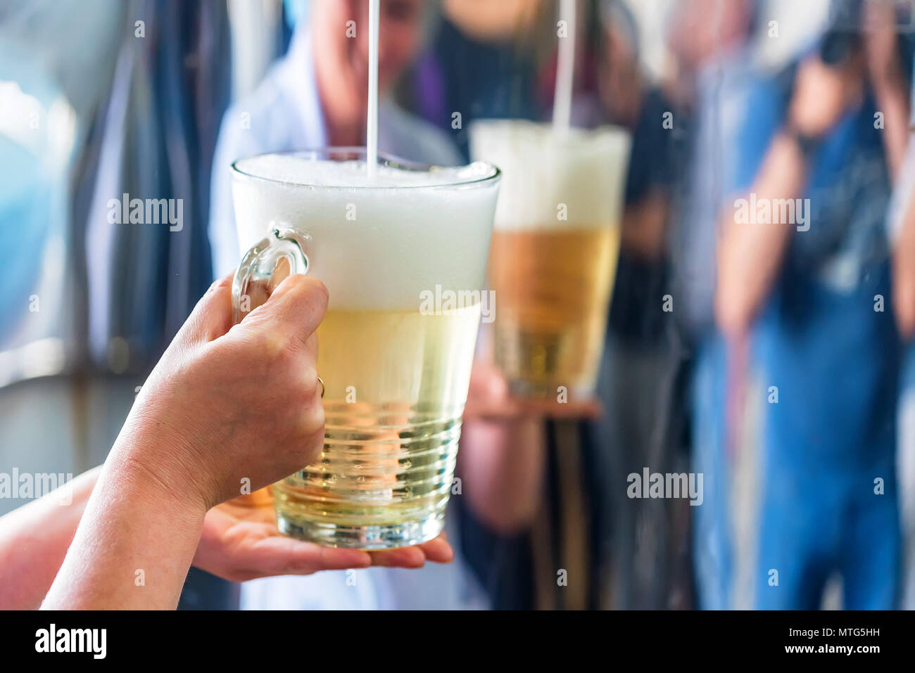 Pouring sparkling wine in glass at winery Stock Photo