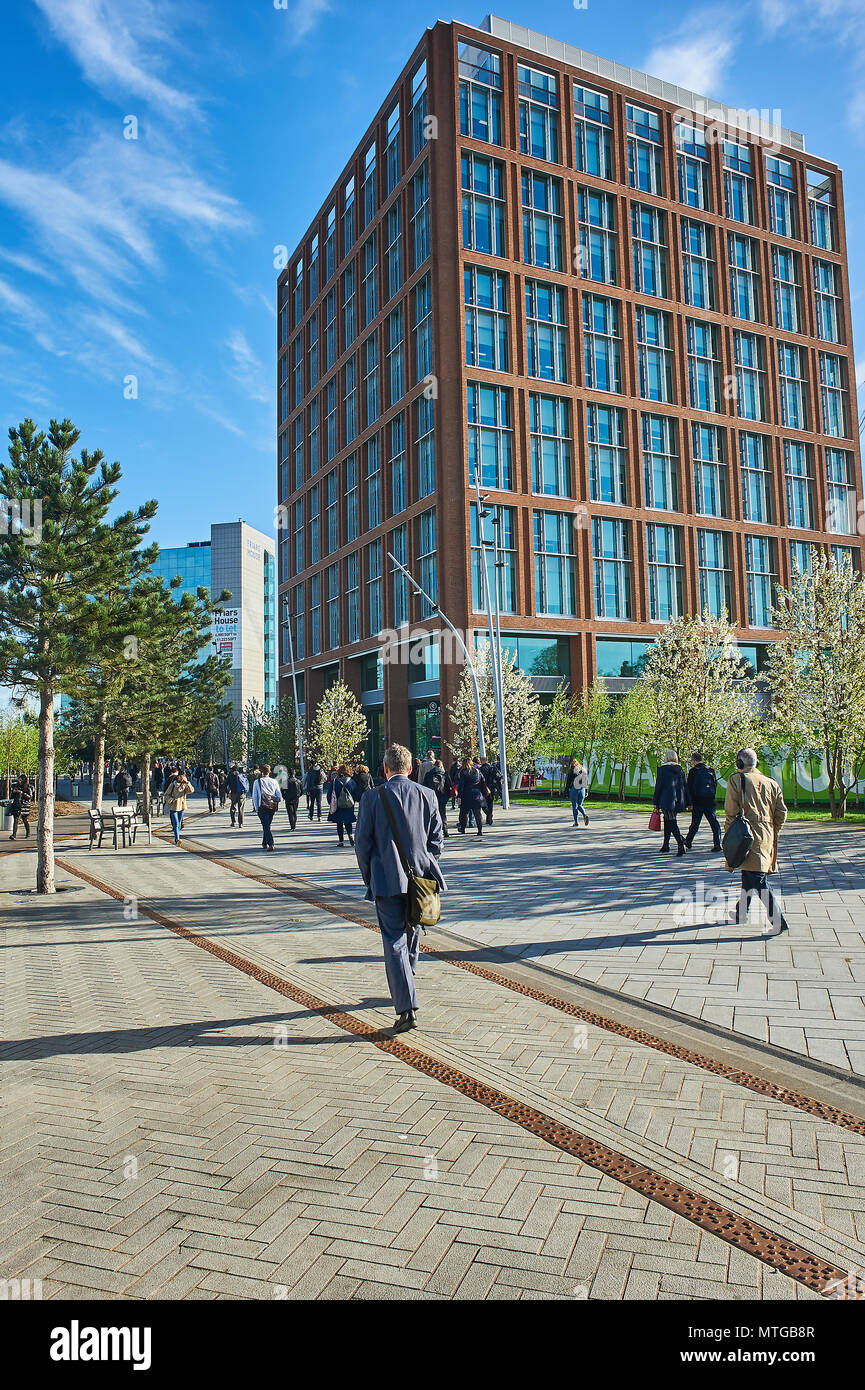 Coventry Friar Gate development site with people walking through the new public realm area - Stock Image