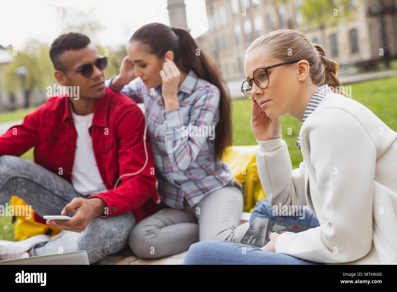 Blonde-haired student feeling thoughtful - Stock Image